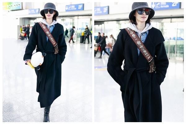 王丽坤现身机场 黑色羊绒大衣尽显率性优雅